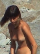 Couple enjoys a naked party at the seaside at Nude Beach Dreams